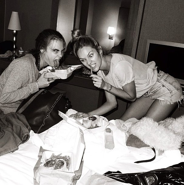 No dieting for these models —Cara Delevingne and Candice Swanepoel prepped for the runway with a late-night snack. Source: Instagram user jeromeduran