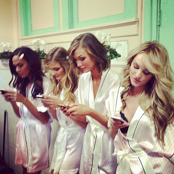 Victoria's Secret has the models as glued to their phones as we are! Source: Instagram user karliekloss