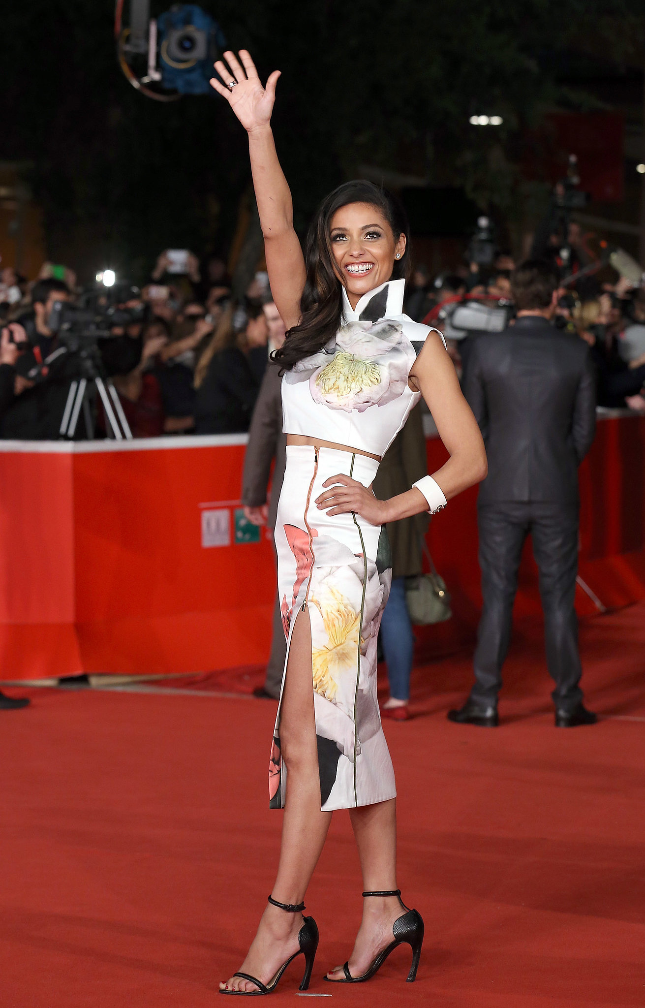 Meta Golding jumped on the crop-top train in a boldly floral ensemble accessorized with classic black ankle-strap pumps.