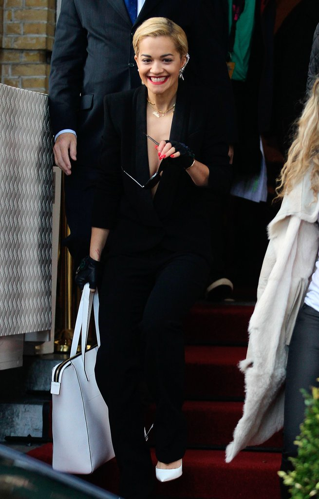 Rita Ora also tried a more classic spin on the suit, adding an oversize white bag for a modern finish.