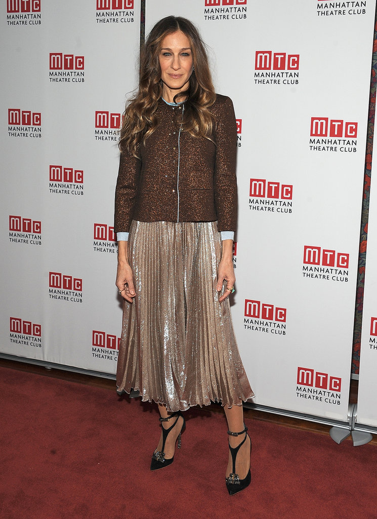 Sarah Jessica Parker looked decadent as a holiday feast in her silk lamé Rochas pleated dress and bronze Sonia Rykiel jacket at the opening night of The Commons of Pensacola. For extra shimmer, she added a tweed topper and ornamented Sophia Webster heels.