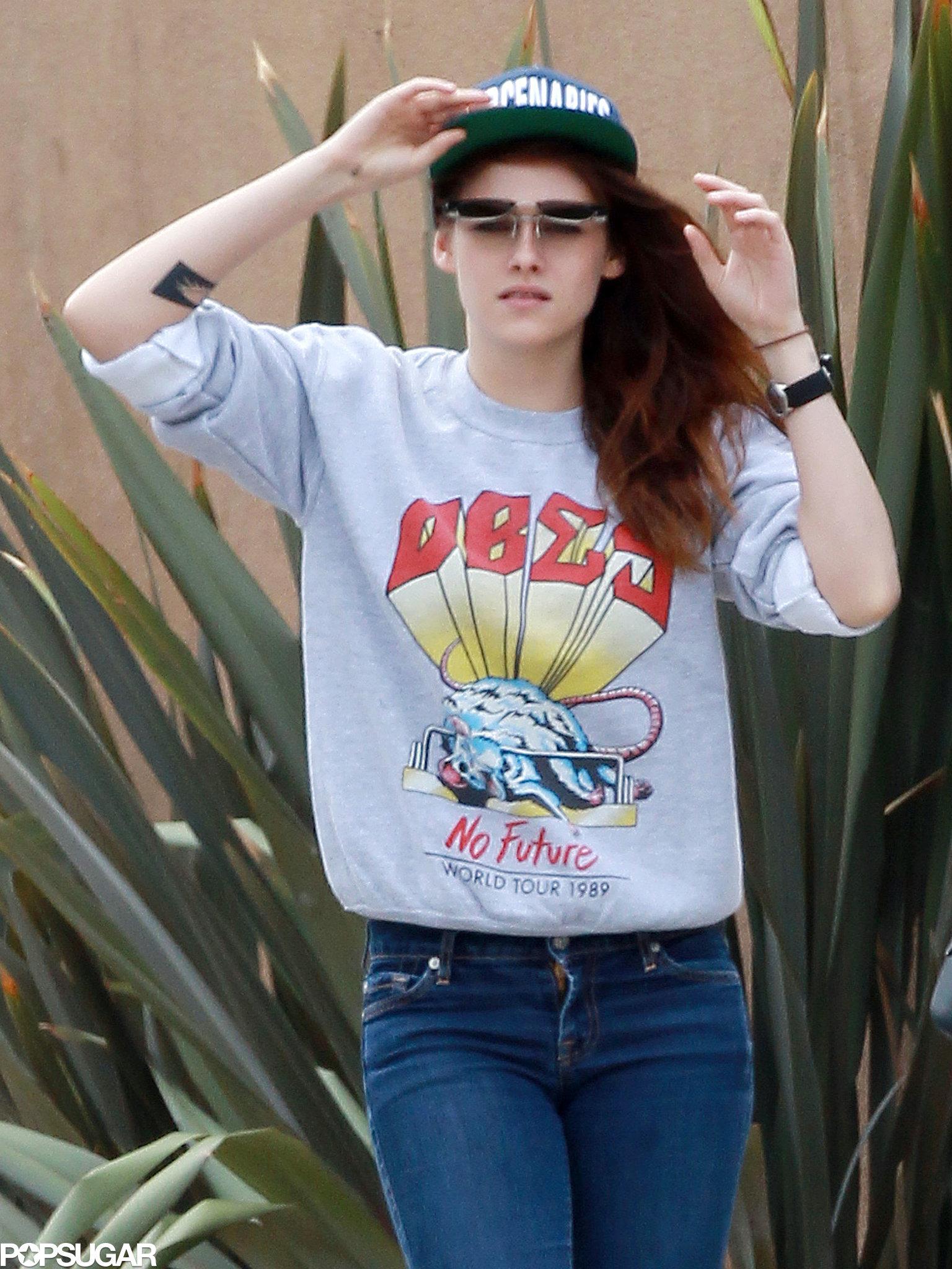 Kristen Stewart wore flip-up sunglasses.