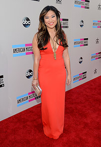 Jenna-Ushkowitz-upped-wow-factor-plunging-orange-gown