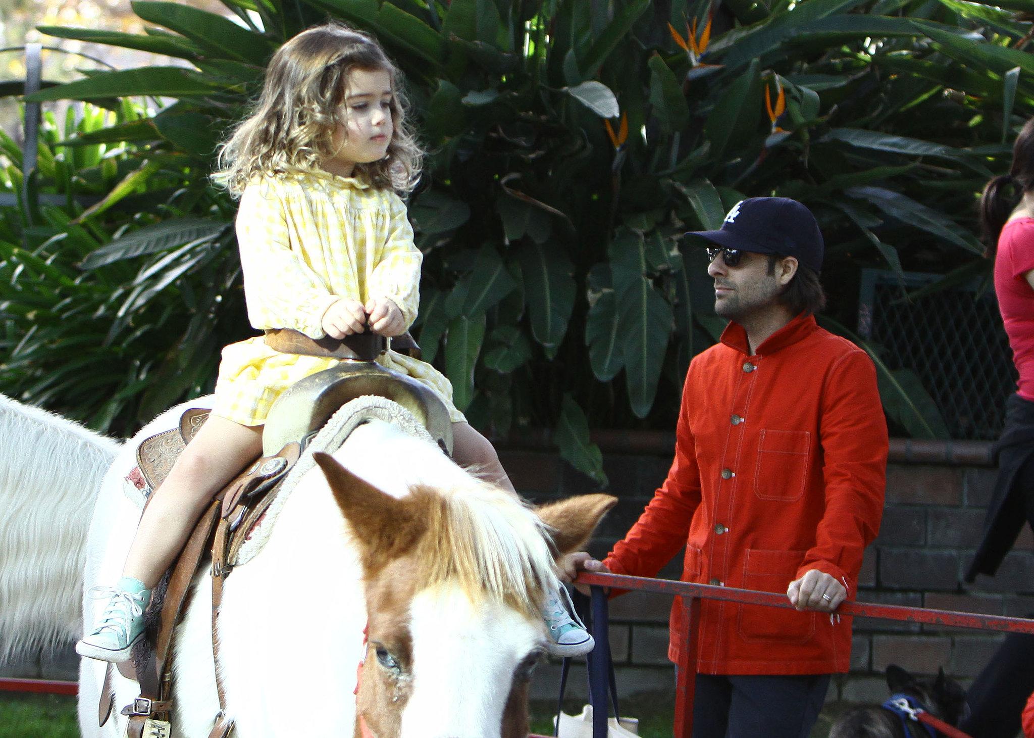 Jason Schwartzman watched as his daughter, Marlowe, rode a ...