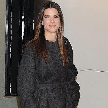 Sandra Bullock Black Belted Coat at Tokyo Airport