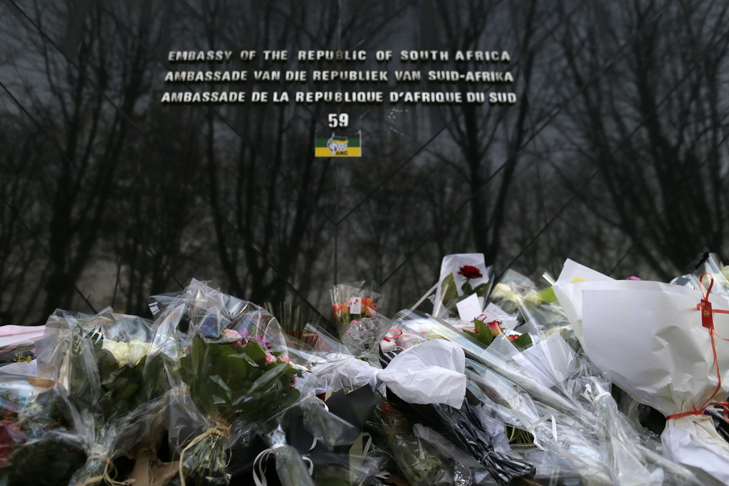 Flowers covered the ground outside the South African Embassy in Paris.