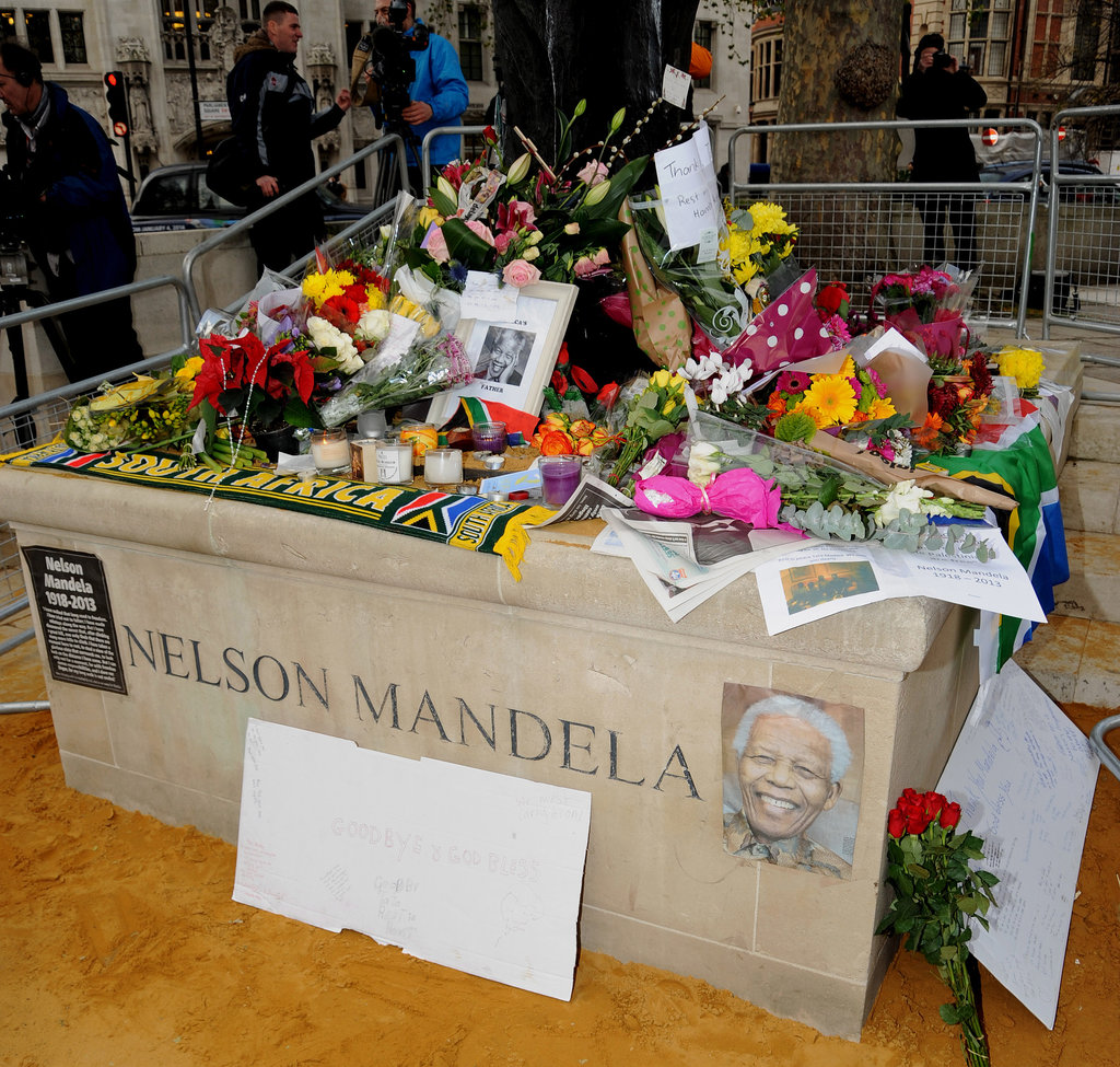 Thoughtful tributes covered the foot of a statue in London's Parliament Square.