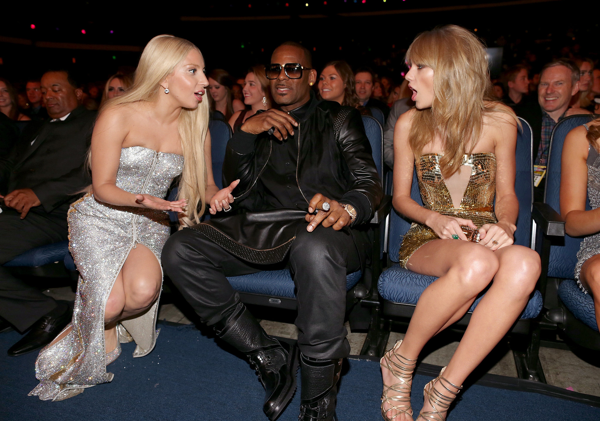 At the AMAs, Lady Gaga and Taylor Swift had a very intense talk while R. Kelly sat between them.