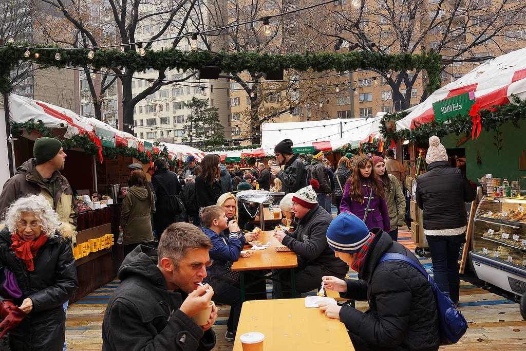 Bundled-up visitors ate in an outdoor holiday market in NYC.