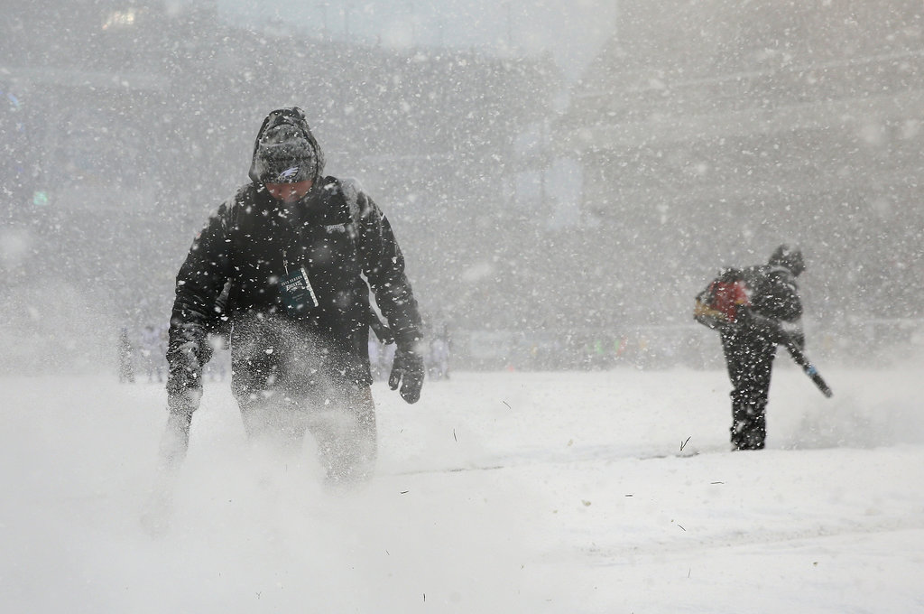 Stadium workers brought snowblowers onto the field to try to clear the lines during the game between the Philadelphia Eagles and the Detroit Lions in Pennsylvania.