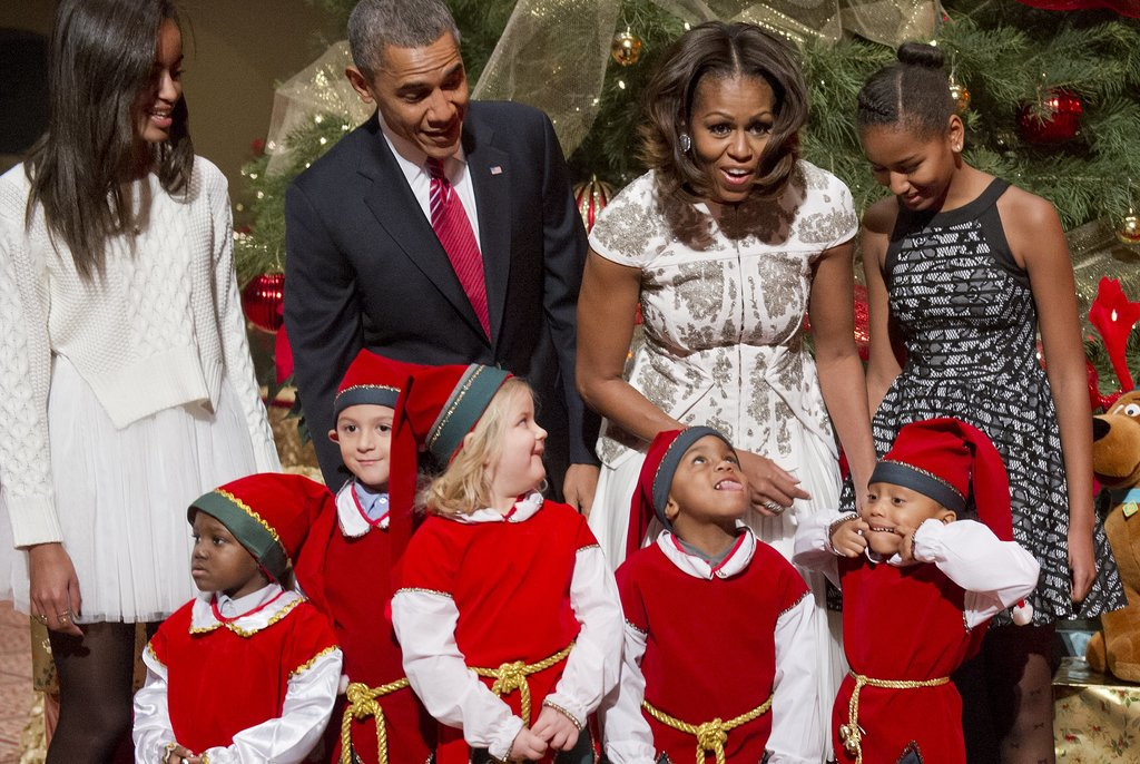 The Obamas joked around with some of the kids dressed as elves, who made silly faces.