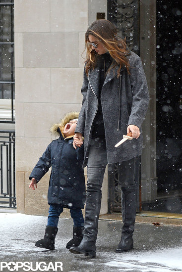 Flynn Bloom tried his best to catch a snowflake with his tongue while taking a walk with mom Miranda Kerr in NYC in December 2013.