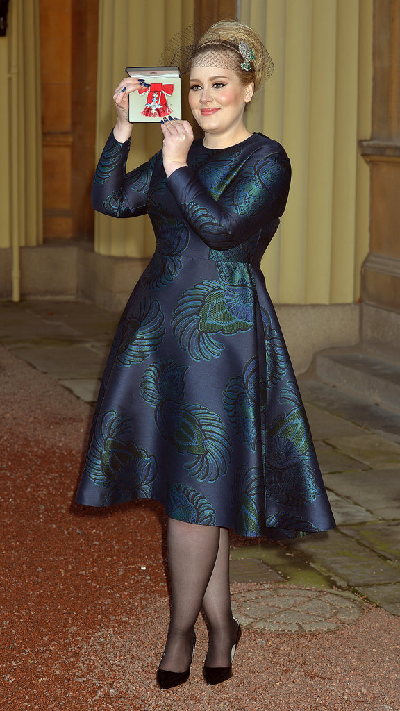 What holiday? Adele had real reason to celebrate when she picked up her Member of the British Empire award in her iridescent Stella McCartney cocktail dress and Philip Treacy veil.