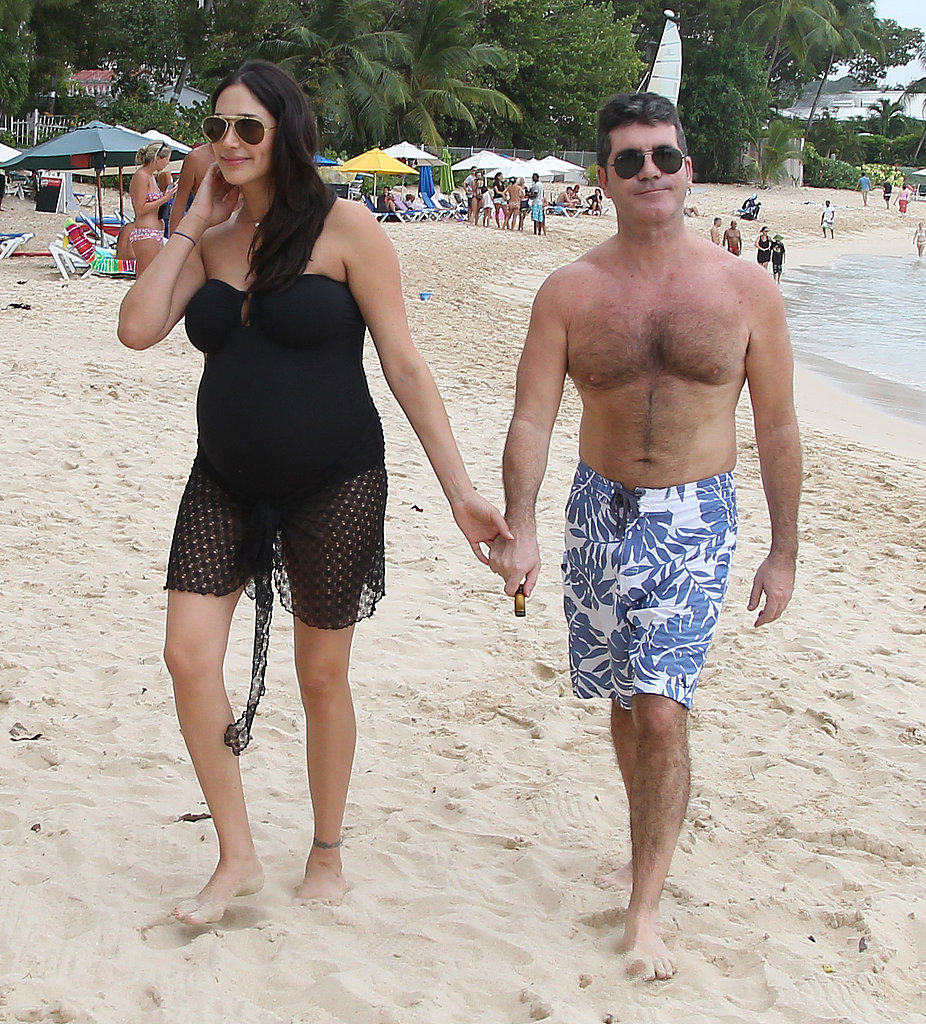 Simon Cowell held hands with his pregnant girlfriend Lauren Silverman on holidays in Barbados in December 2013.