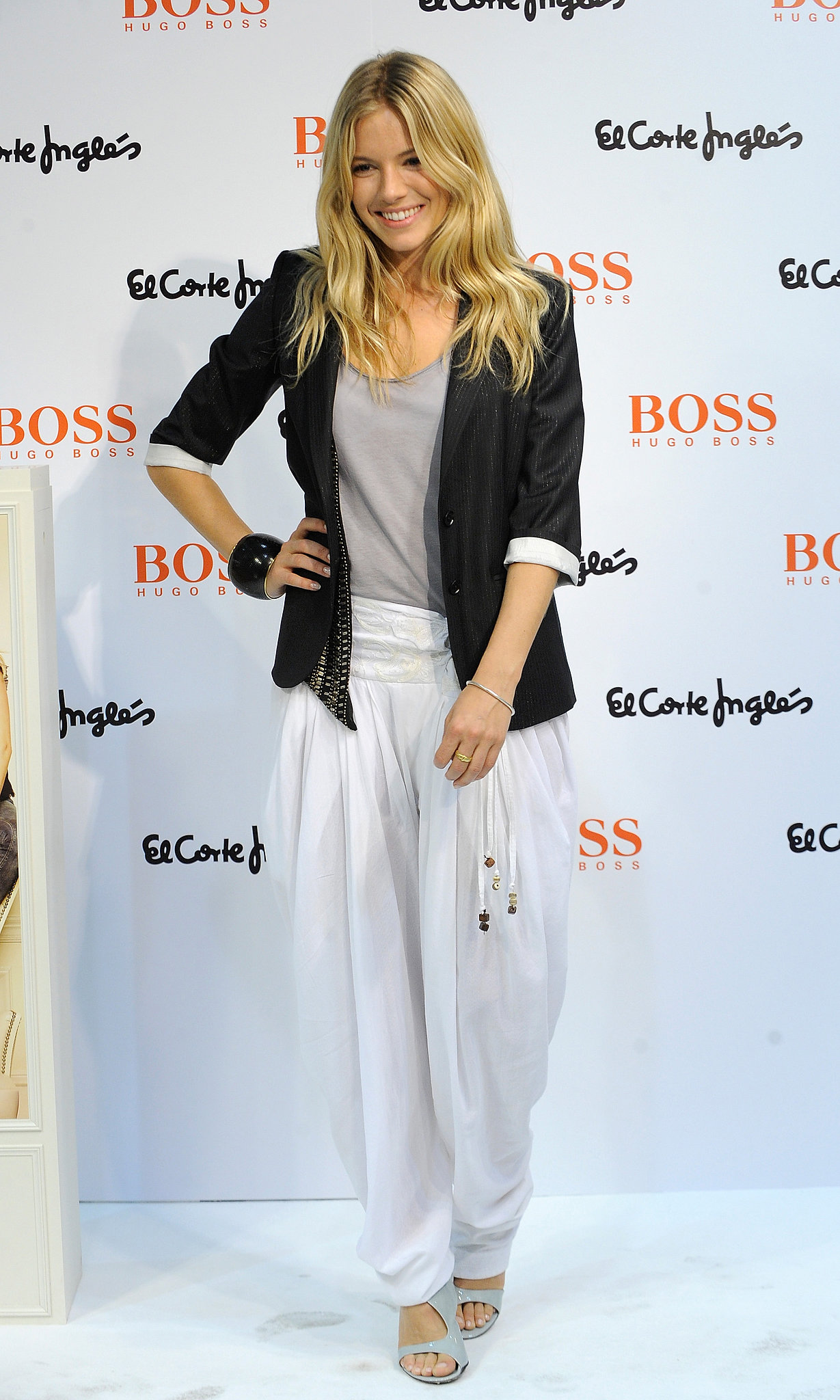 Sienna teamed harem pants with a blazer for an event in 2009.