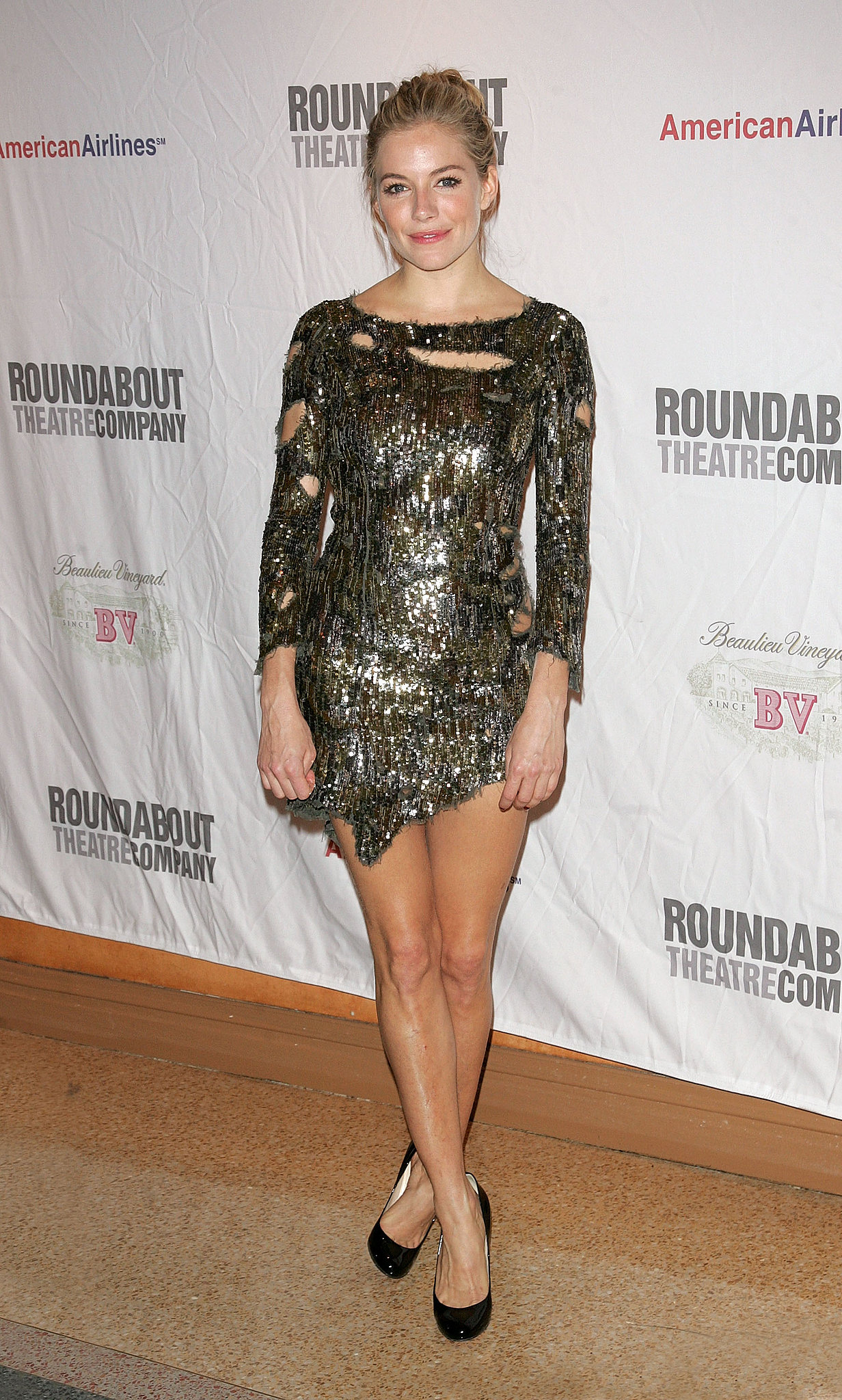 Sienna wore a shredded, metallic mini to celebrate the opening of After Miss Julie on Broadway in 2009.