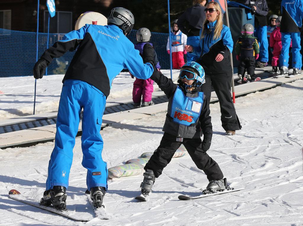 Zuma got a fist bump from his ski instructor.
