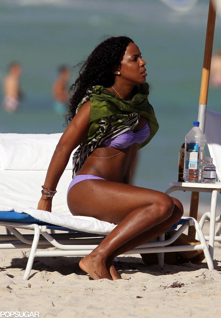 Kelly showed off her fit figure in a purple bikini.