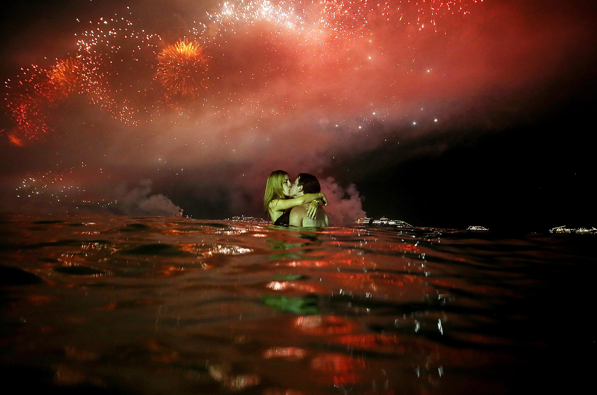 TOP 10 NEW YEAR's EVE DESTINATIONS AROUND THE WORLD couple kissed water beside Copacabana Beach New Year