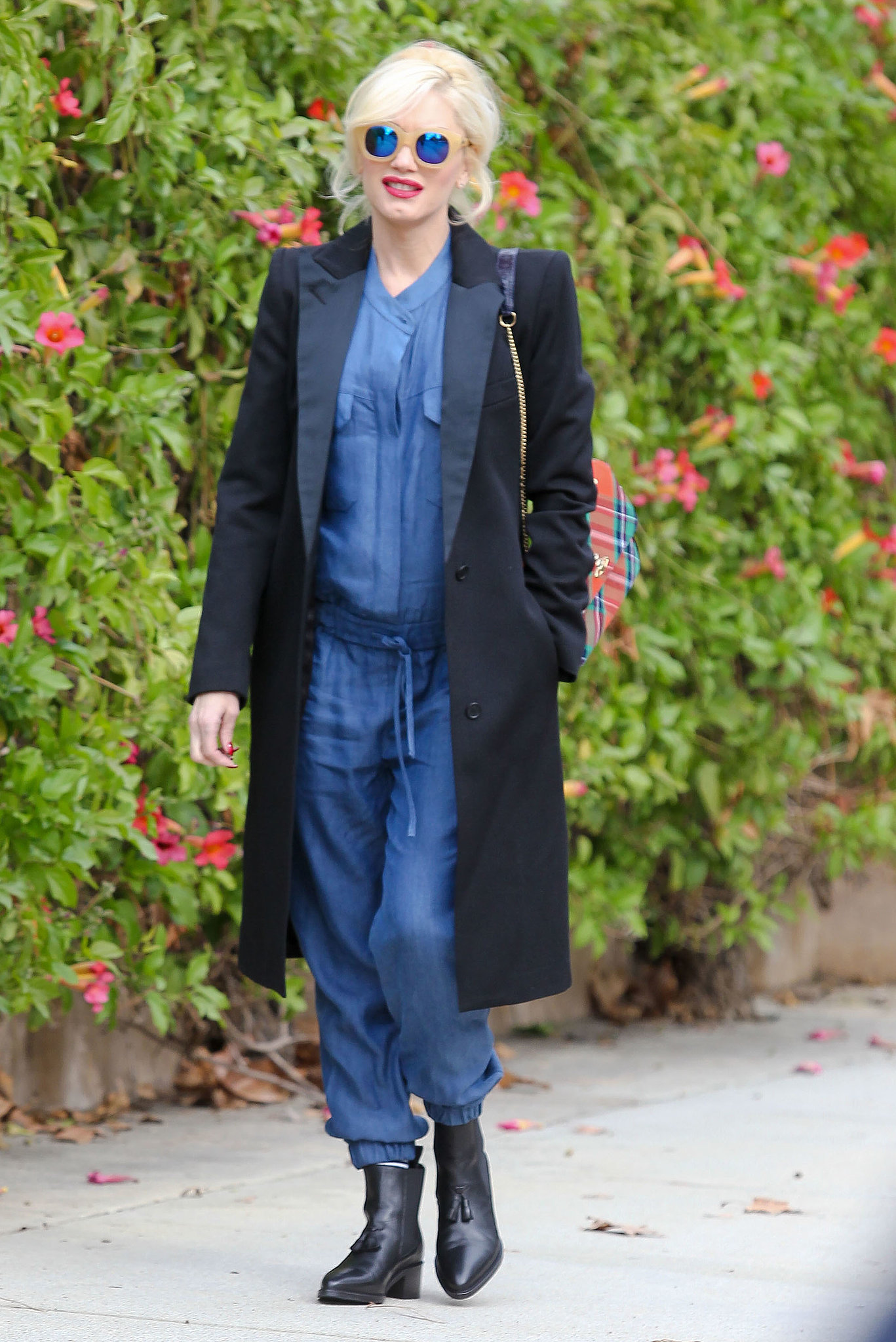 She might've been pushing the envelope with her denim jumpsuit, but that Smythe coat was all business! The sharp lapels were in line with a tuxedo blazer, though this version reached down to hit at the knee.