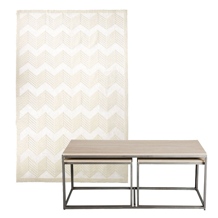 This combination is crisp and classic. Chevron is done right with this rug ($3,010-$4,480), especially set against a creamy travertine table ($1,789, originally $1,999).