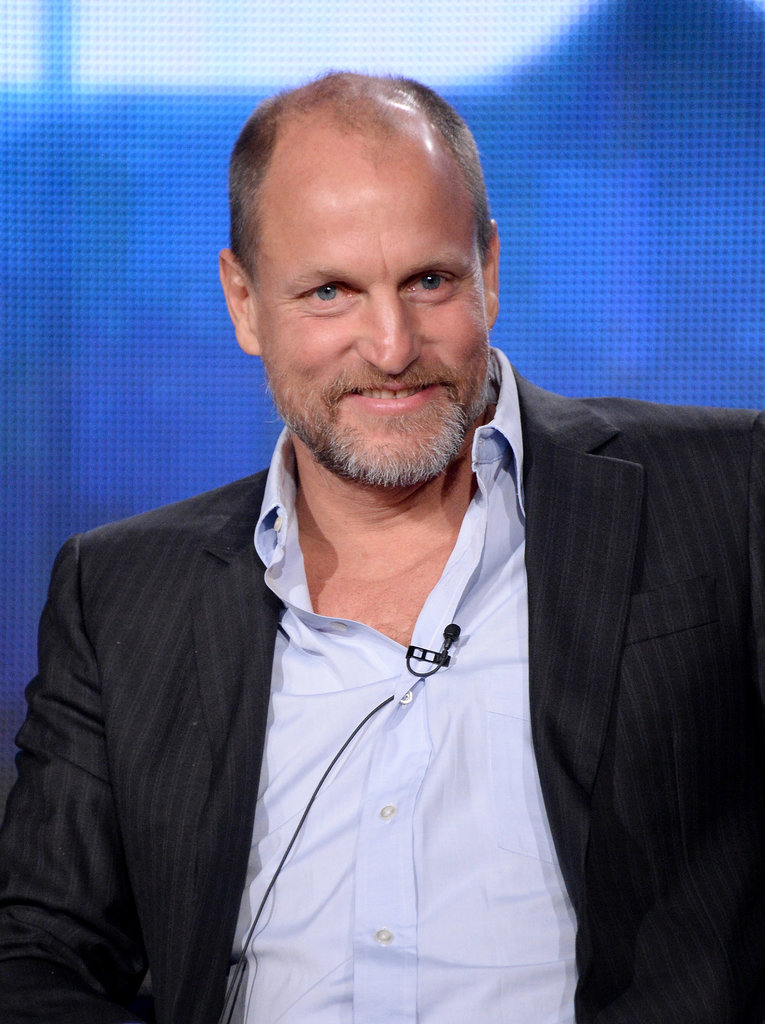 Woody Harrelson grinned under the spotlight.