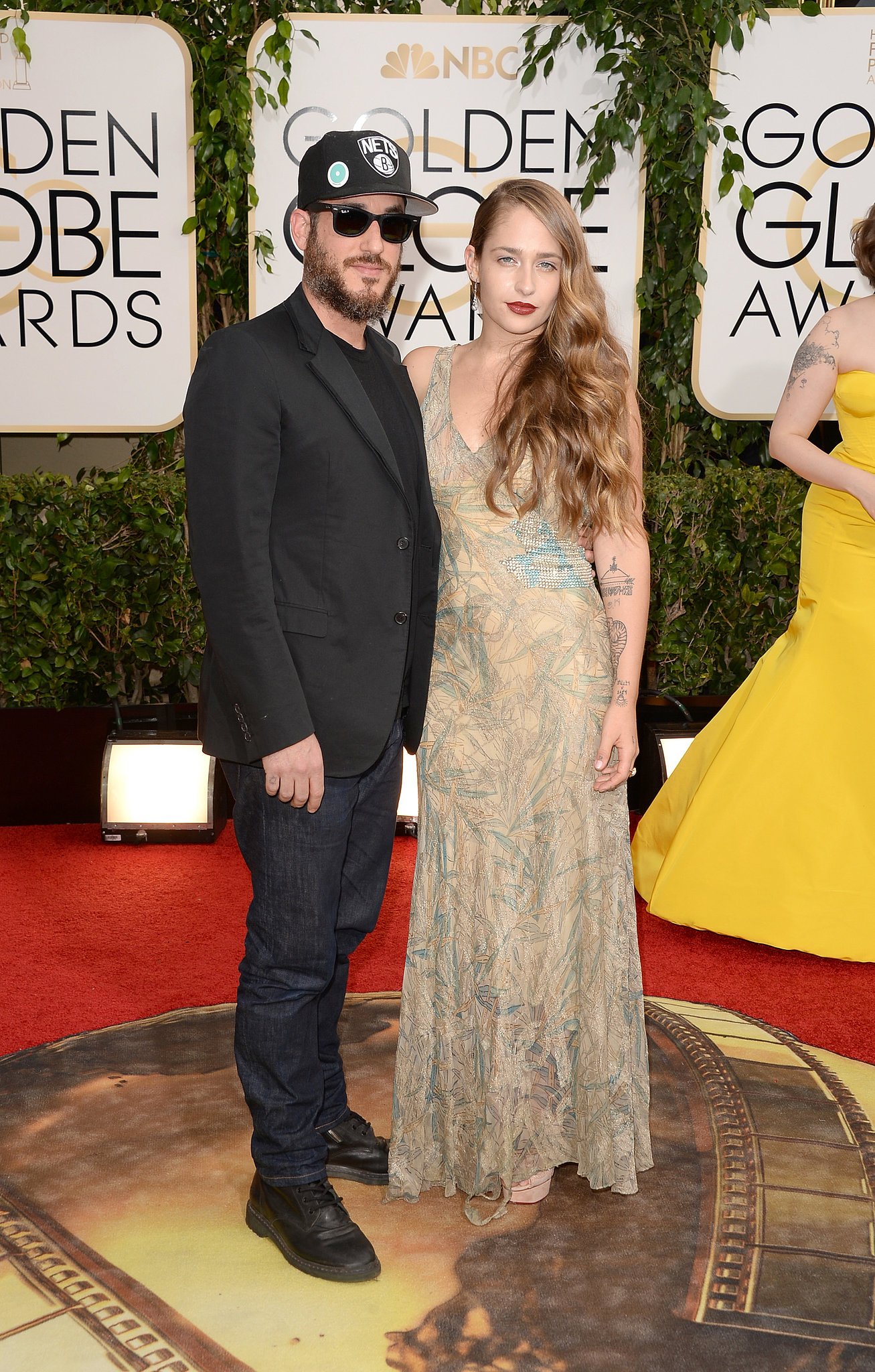 Girls star Jemima Kirke walked the red carpet with her casually dressed husband, Michael Mosberg.