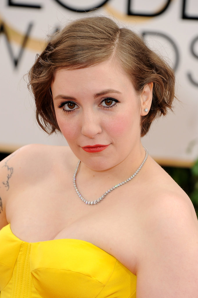 Lena Dunham was Spring-ready with rosy cheeks and red-hot lips. Thick black eyeliner and punk-rock waves juxtaposed her sweet beauty look.