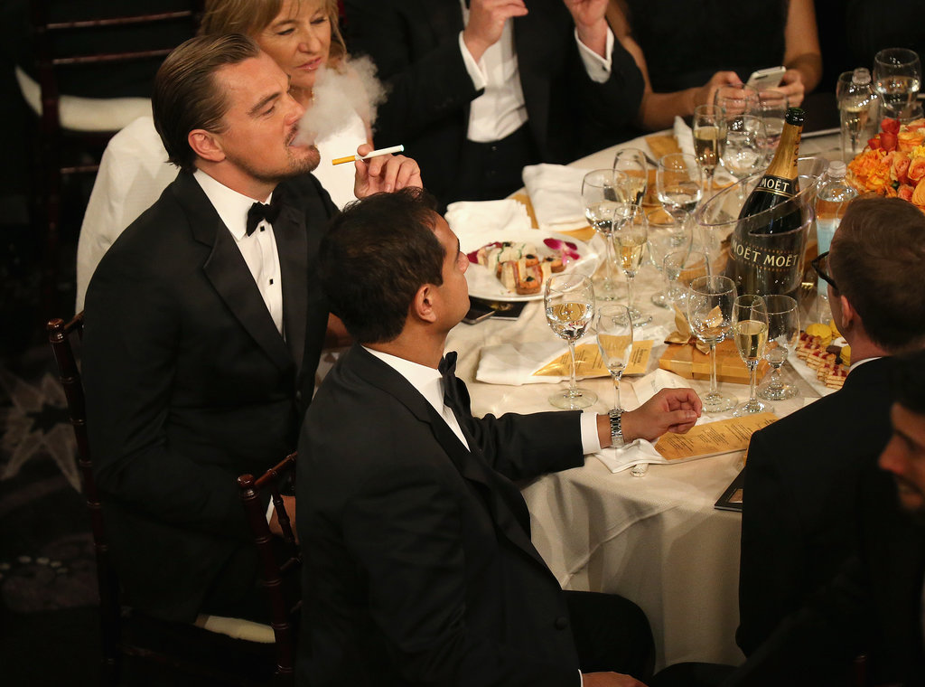 Leo lit up an electronic cigarette at his table, where he sat with the rest of his The Wolf of Wall Street cast.  Source: Christopher Polk/NBC/NBCU Photo Bank/NBC