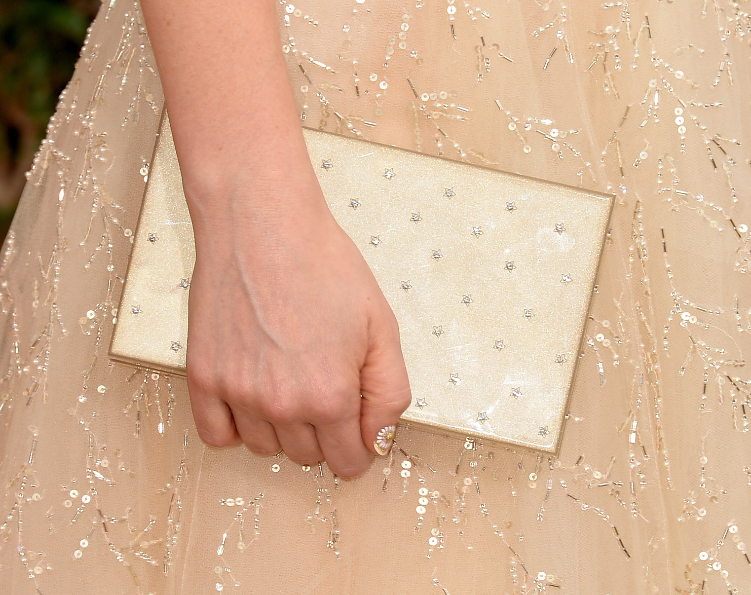 Playing off the pretty palette of her dress, Zooey added a pearl-adorned clutch.