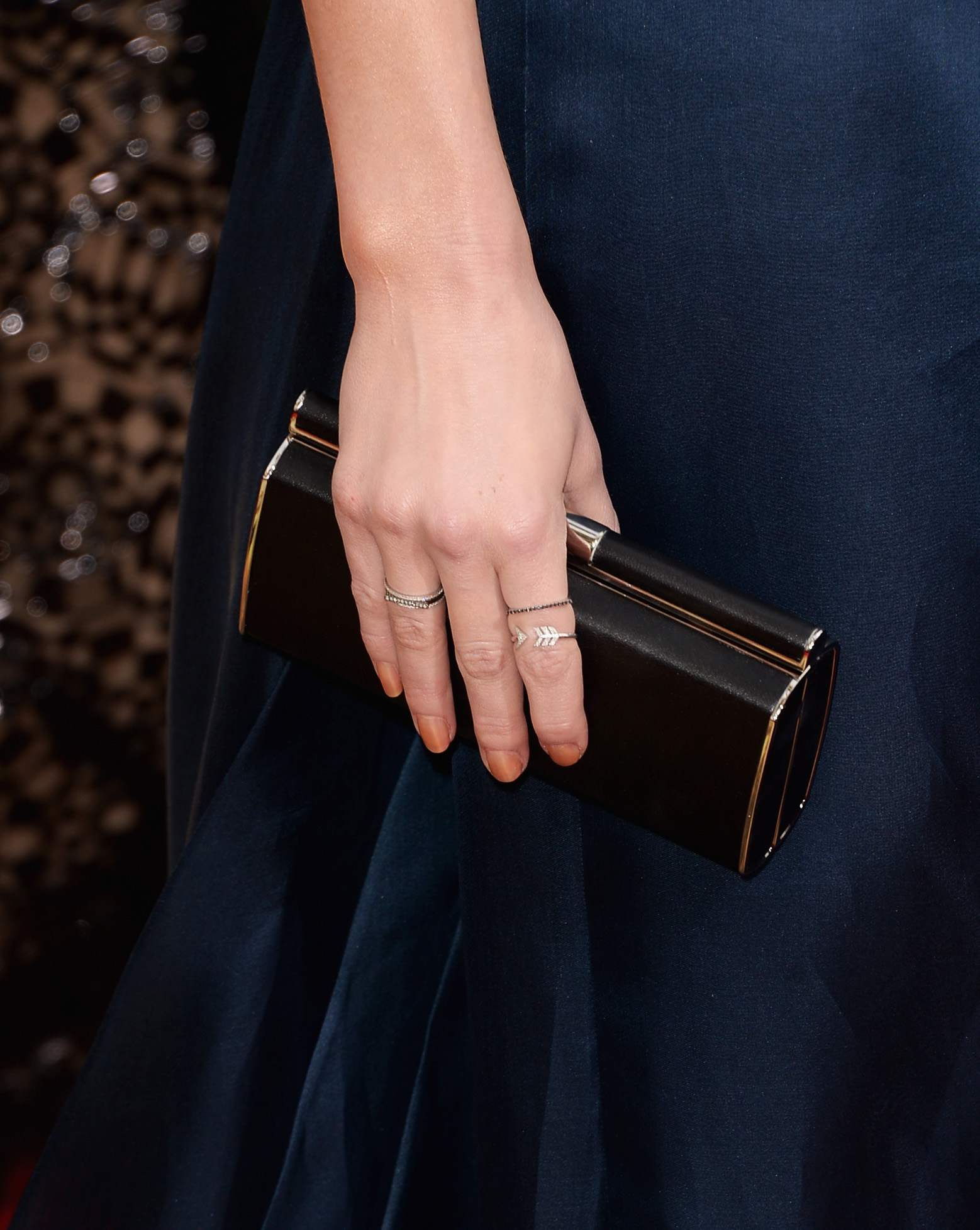 Amber Heard kept the colors dark with a black Versace clutch to accompany her navy gown.