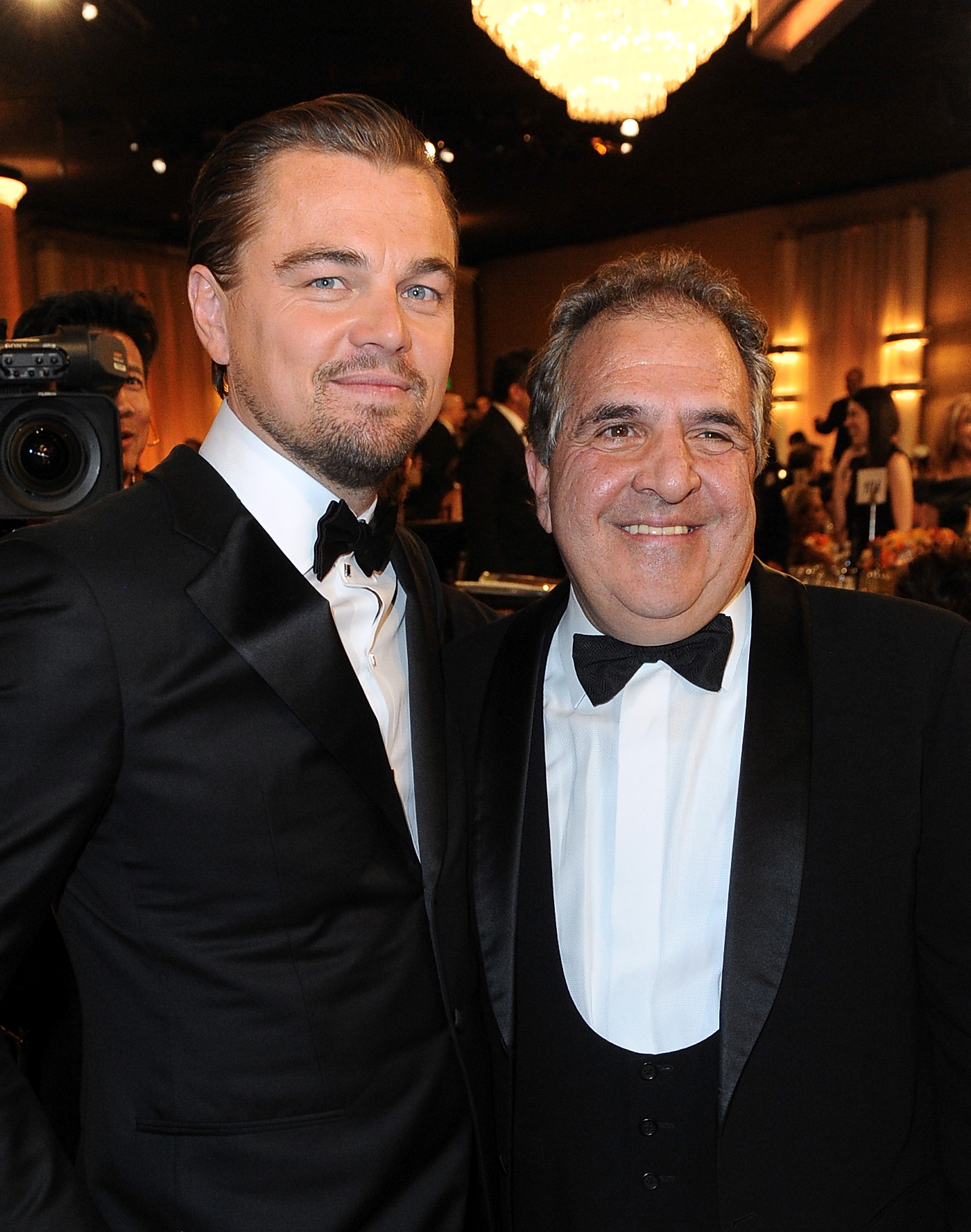 He and Fox executive Jim Gianopulos smiled in their tuxes.