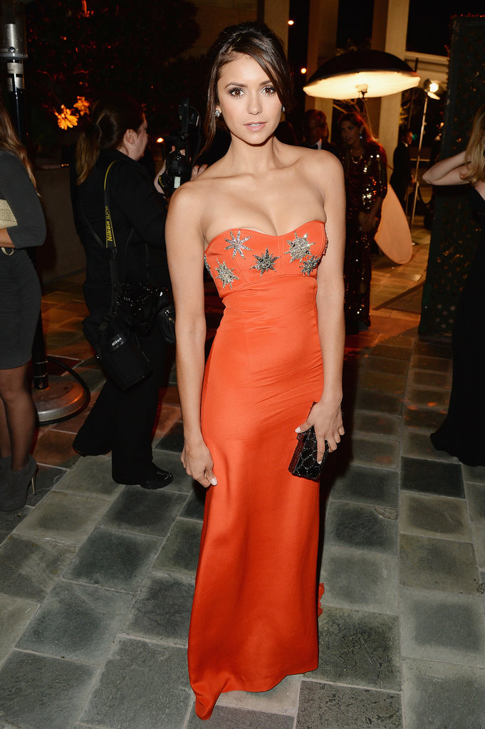 Nina Dobrev wore an orange Pucci gown.