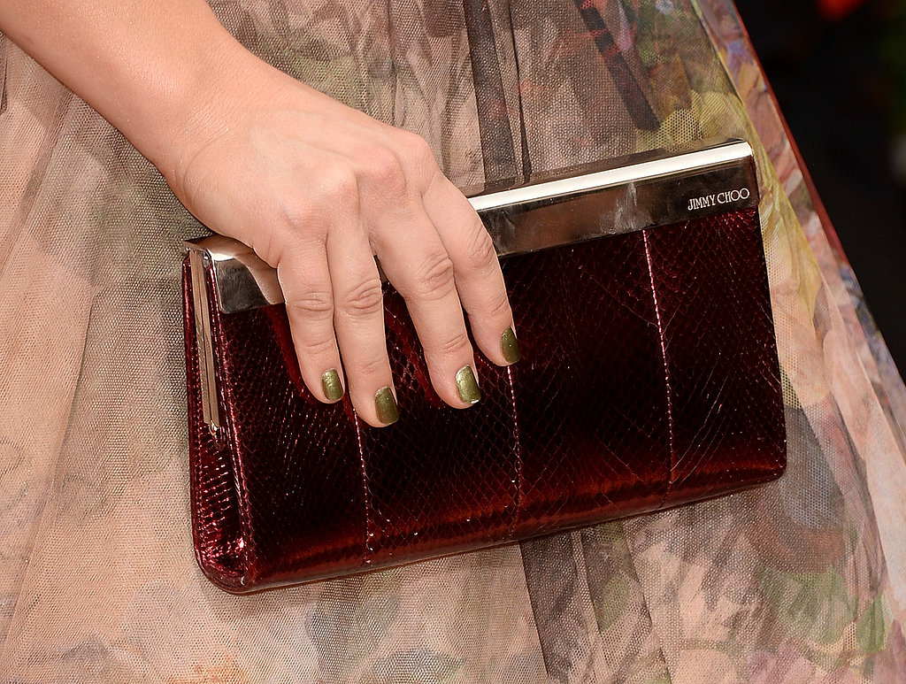 Kaley Cuoco's exotic Jimmy Choo clutch offered a deep contrast to her floral gown.