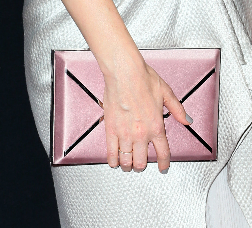Kate Mara played a soft, metallic envelope clutch against her silver gown.