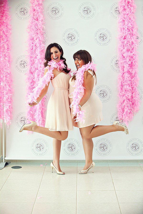 You obviously need pink feather boas for photo ops.