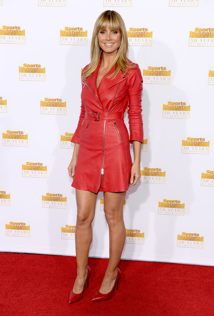 Heidi Klum kept quite covered up in this red jacket dress.