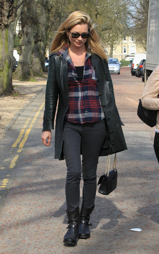 Kate added a bit of glamour to a pub trip with her Chanel handbag, but the rest of the outfit stayed casual. A checked shirt and long coat topped the omnipresent skinny jeans and ankle boots.