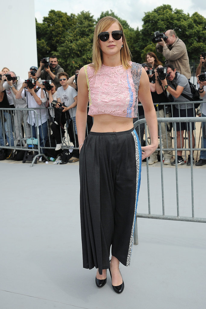 Jennifer Lawrence donned head-to-toe Dior, a rainbow-hued lace shirt with asymmetrical trousers, while taking in the Christian Dior show during Paris Haute Couture week in July 2013. Where to Wear: A sunrise horseback-riding session.