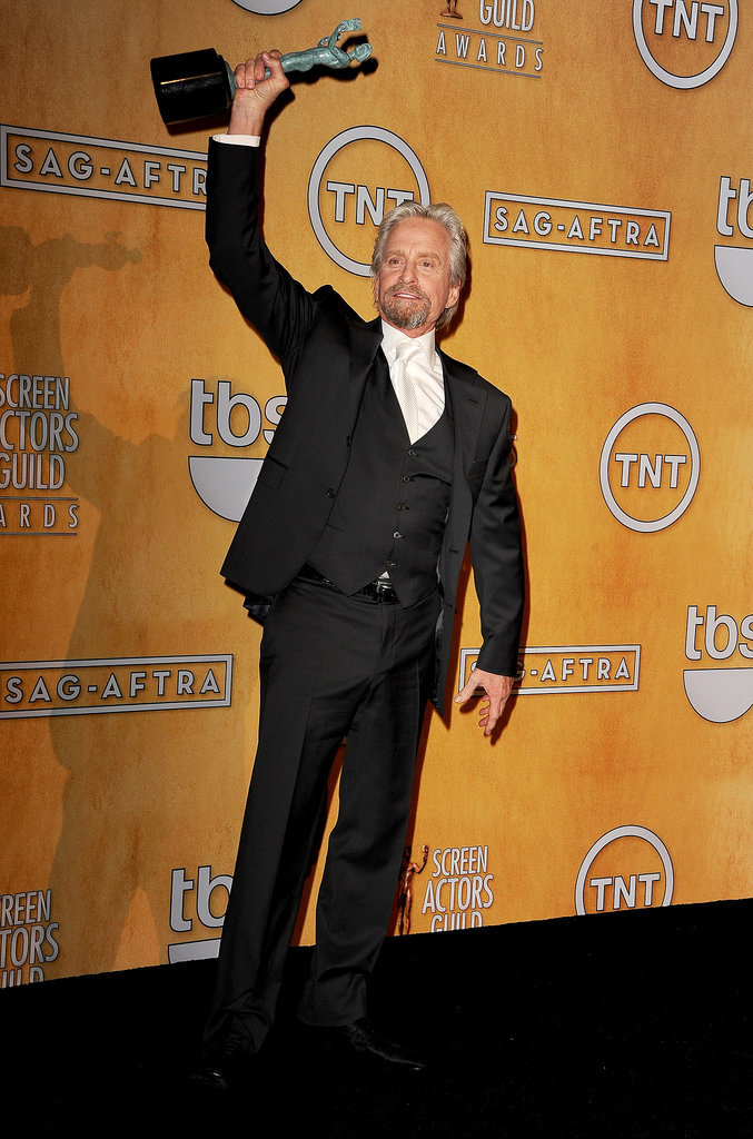 Michael Douglas raised his award after winning for his work in Behind the Candelabra.