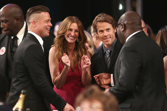 Brad Pitt cracked up with Julia Roberts, Danny Moder, and Steve McQueen during the SAG Awards.
