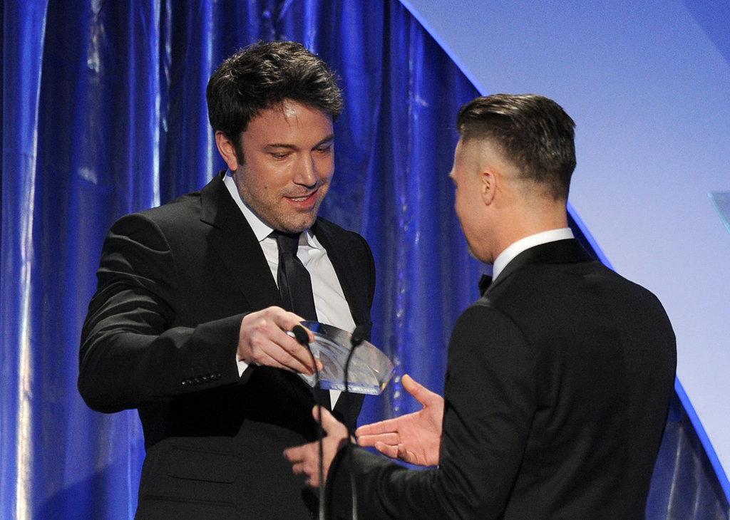 Ben Affleck handed Brad Pitt his Producers Guild Award.