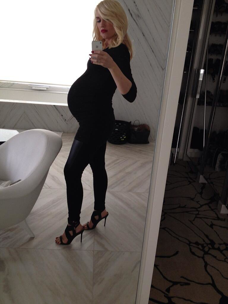 "Gwen Stefani shared a photo of her baby bump, saying, ""bump it #allblack #inappropriateshoes #capturethemoment #miracle."" Source: Twitter user gwenstefani"