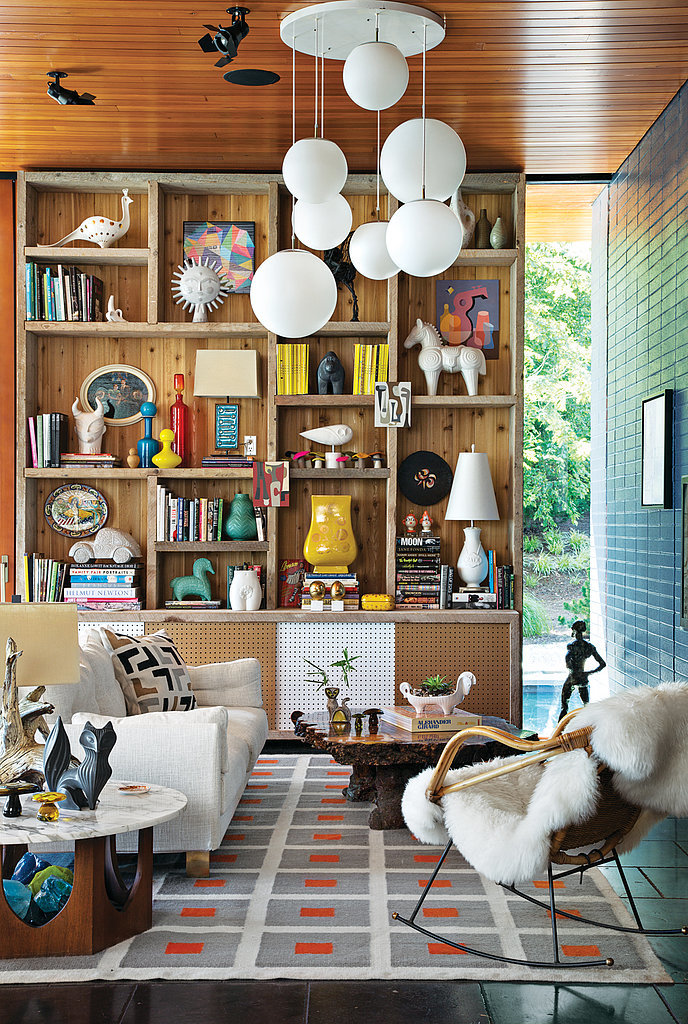 Perfectly reflecting Adler and Doonan's keen aesthetic, a wide array of colors and theatrical elements grace the home's interior. Aside from being filled with several of Adler's famed designs (the Peter rug and Malibu sofa to name a few), the use of natural textiles makes the space to feel cozy.  Photo by Floto + Warner via Dwell Magazine