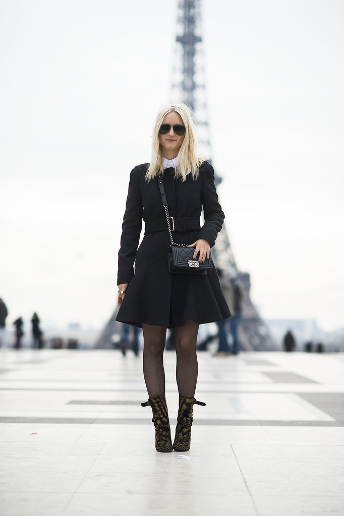 The fashion girl's version of all the right stuff — a classic coat, slick shades, statement boots, and a Chanel bag.  Source: Le 21ème | Adam Katz Sinding