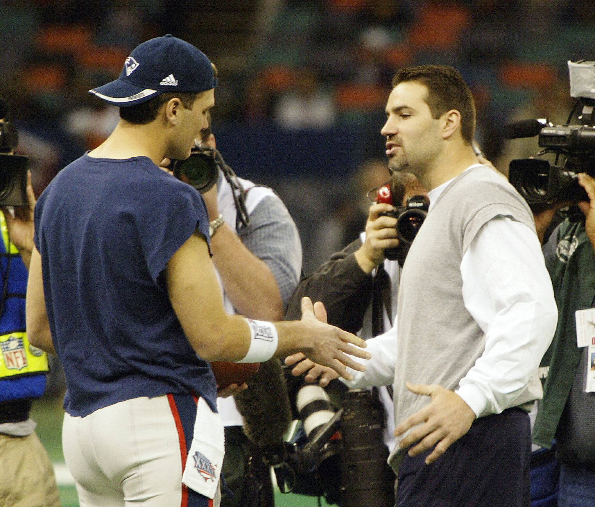 The game in 2002 in Louisiana called for cutoff sleeves from Tom Brady.
