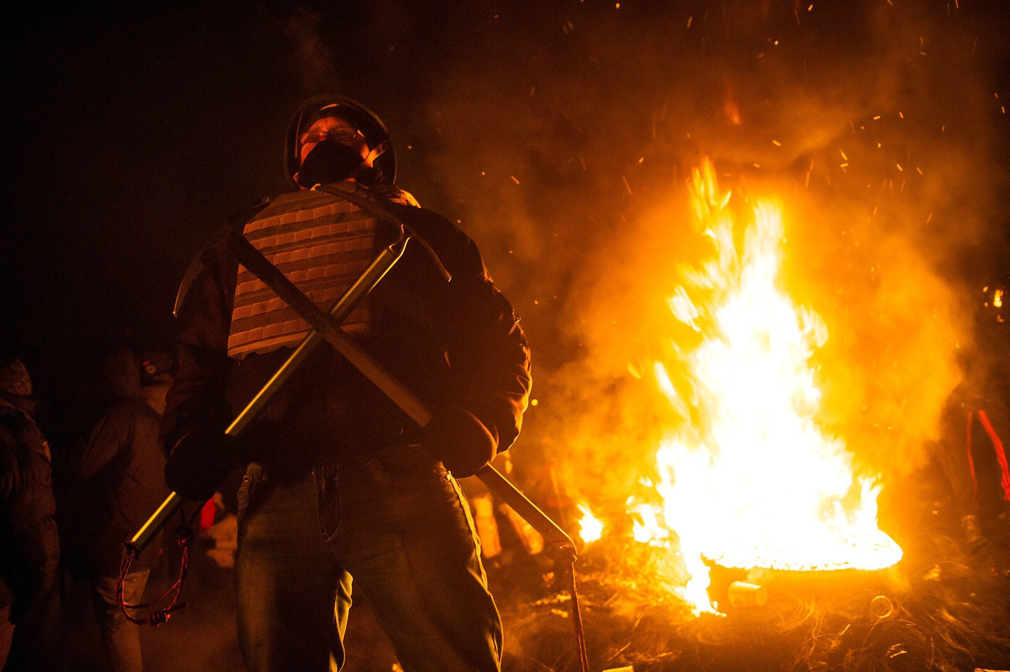 They burned tires beside their barricade in Kiev.