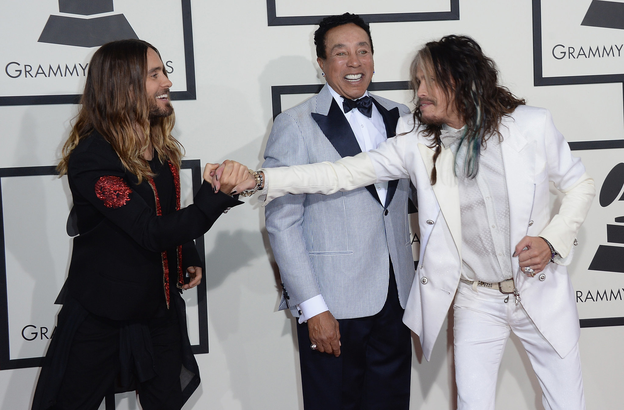 Jared clasped Steven Tyler's hand as Smokey Robinson looked on.