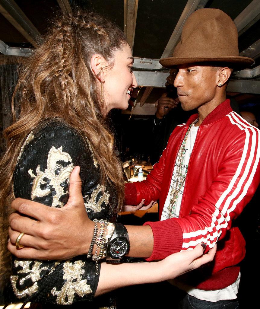Pharrell and Sara Bareilles embraced backstage.