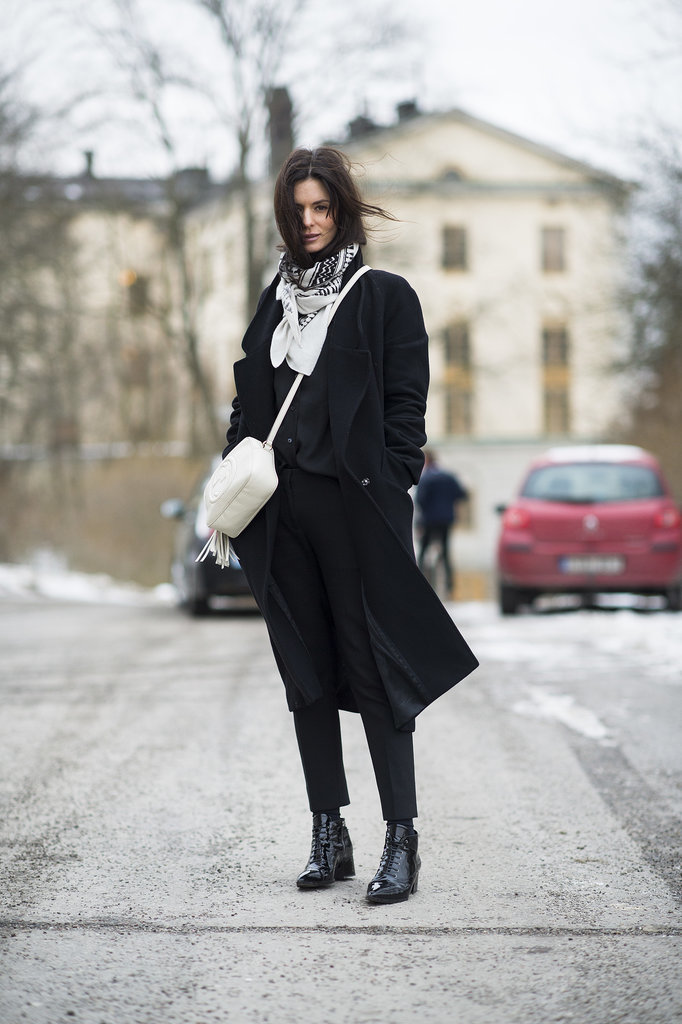 Black and white done right, with a chic bag and a flash of print on her scarf.  Source: Le 21ème | Adam Katz Sinding